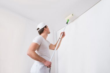 Painter Painting On Wall