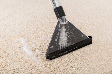 Vacuum Cleaner On Wet Rug