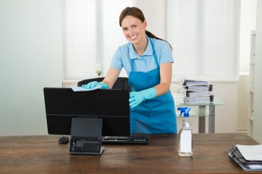 Woman In Workwear Rubbing Desktop