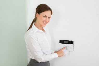 Businesswoman Enter Code on Security System