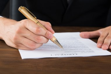 Businessperson Hands With Pen