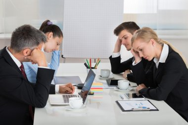 Unhappy Businesspeople In Business Meeting