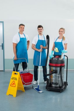 Workers With Cleaning Equipments