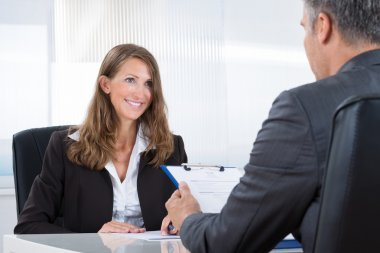 Manager Interviewing A Female Applicant