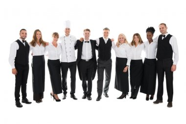 Restaurant Staff Standing With Arms Around