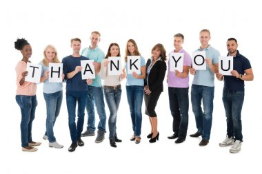 People Holding Thank You Sign