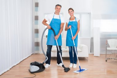 Two Janitors With Vacuum Cleaner And Mop