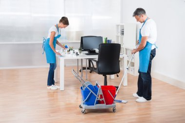 Cleaners With Cleaning Equipments Cleaning The Office