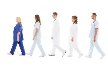 Medical Professionals Walking In Row