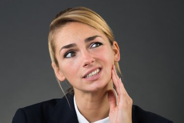 Businesswoman Suffering From Tooth Ache