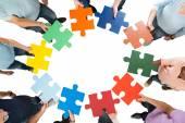 Unternehmen Team Holding Puzzleteile