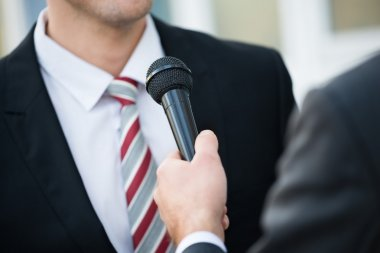 Journalist Taking Interview Of Businessman