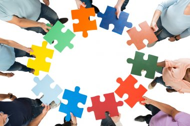 Business Team Holding Jigsaw Pieces
