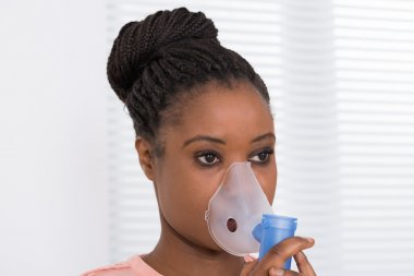 Young Woman Using Oxygen Mask