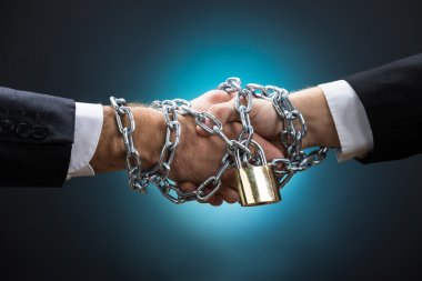 Chained Businessmen Shaking Hands