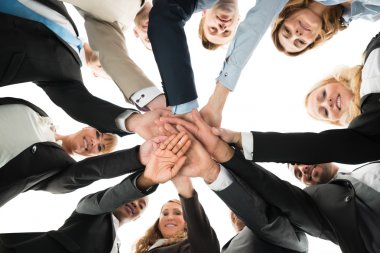Confident Business Team Stacking Hands
