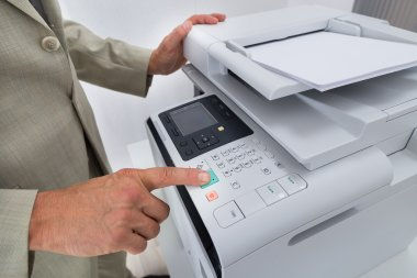 Businessman Pressing Printer's Button