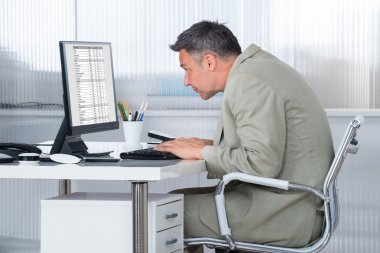 Concentrated Businessman Using Computer