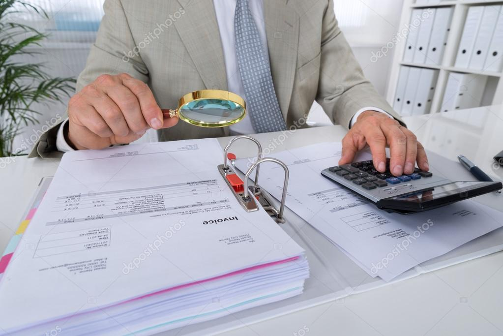 Accountant Holding Magnifying Glass