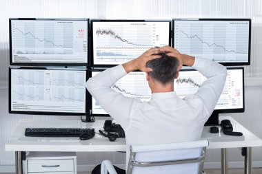 Trader With Hands On Head