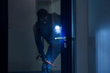 Thief  Trying To Break Door