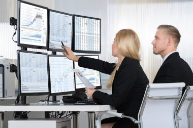 Financial Workers Analyzing Data