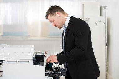 Businessman Adjusting Cartridge