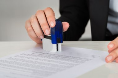 Businesswoman Stamping Contract Document