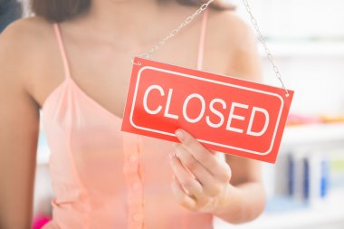 Owner Holding Closed Sign