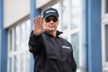 Security Guard Making Stop Gesture