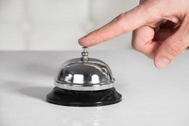 Businessman Ringing Service Bell