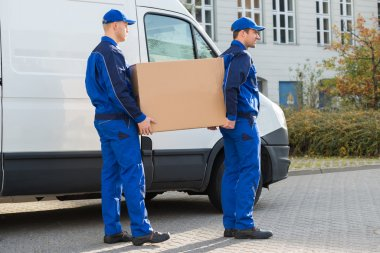 Delivery Men Carrying Cardboard Box