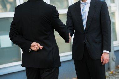 Dishonest Businessman Shaking Hands