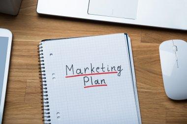 Marketing Plan Written On Notepad