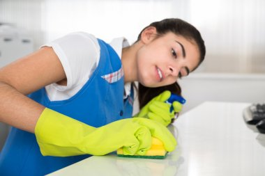 Janitor Cleaning Desk With Sponge