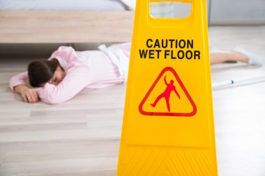 Wet Floor Sign With Fainted Housekeeper