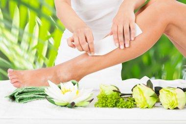 Waxing Woman's Leg