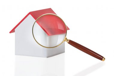Magnifying Glass And House Model