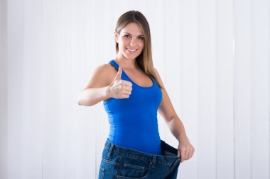 Woman Showing Weightloss