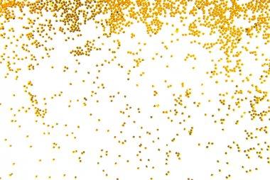Golden glitter falling isolated on white