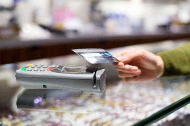 Woman paying on credit card