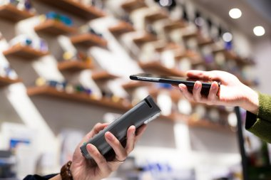 Woman paying by NFC technology