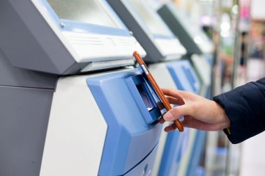 Woman pay with cellphone by NFC on ticketing system