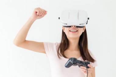 Woman playing video games with VR device
