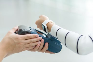 Woman paying by smartwatch