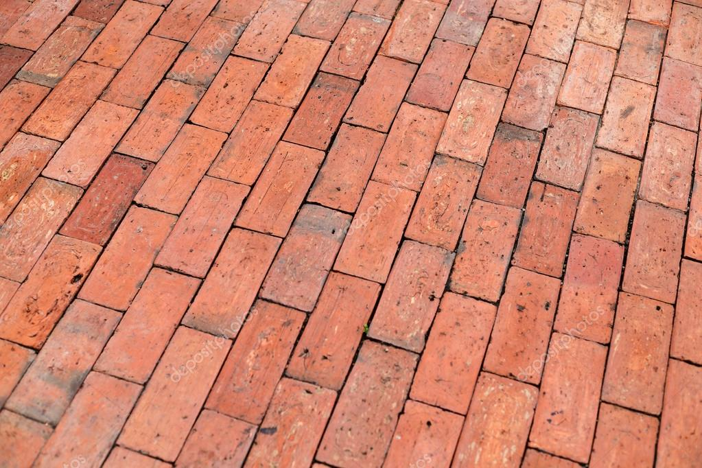 Red Paving Stones : Red brick paving stones on a sidewalk — stock photo