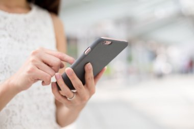 woman using mobile phone for sms
