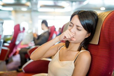 Woman coughing inside boat
