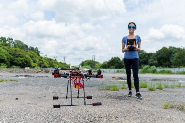 woman controlling drone quadcopter