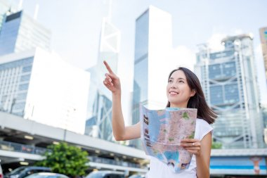 woman using city map in Hong Kong